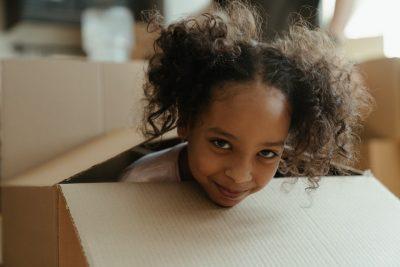 little girl in the cardboard box