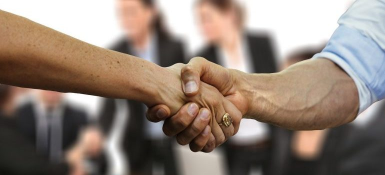 A handshake between two people.