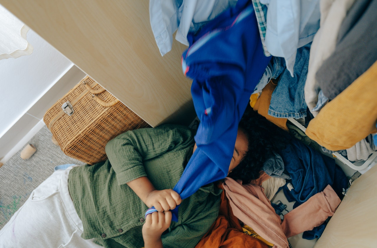 girl and a pile of clothes