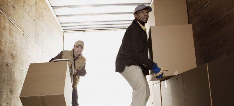 Men loading boxes onto truck