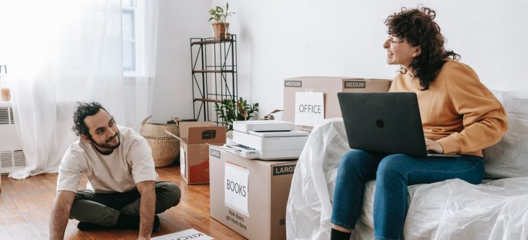 person looking online for furniture movers Los Angeles County