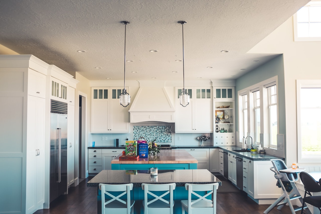 a kitchen with table and chairs is where you start downsizing from a house to an apartment