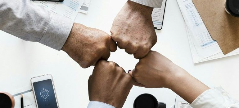 A team of North Hills movers fist bumping.