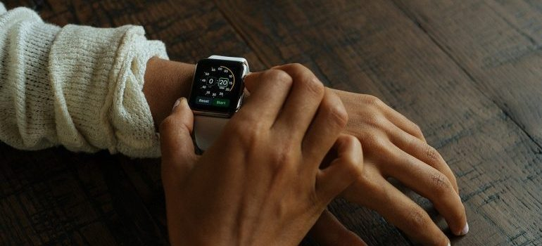 A person with a smart watch on the wrist.