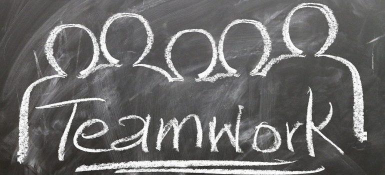 Teamwork drawing on a blackboard.