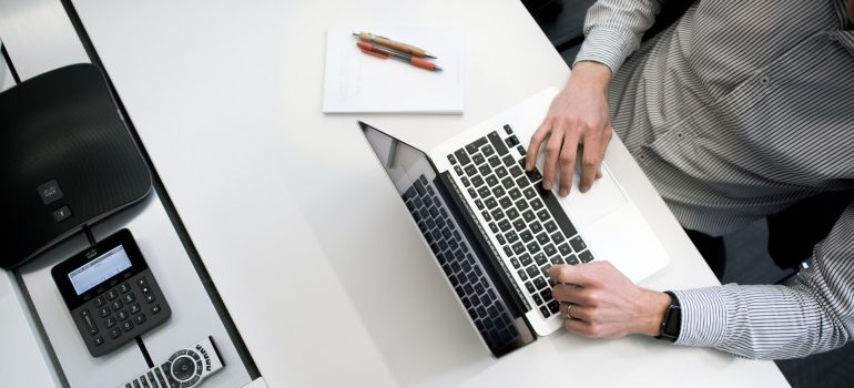 person typing on the laptop