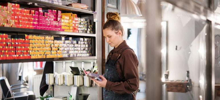 Woman is checking beauty salon things, preparing when moving a beauty salon to Burbank.