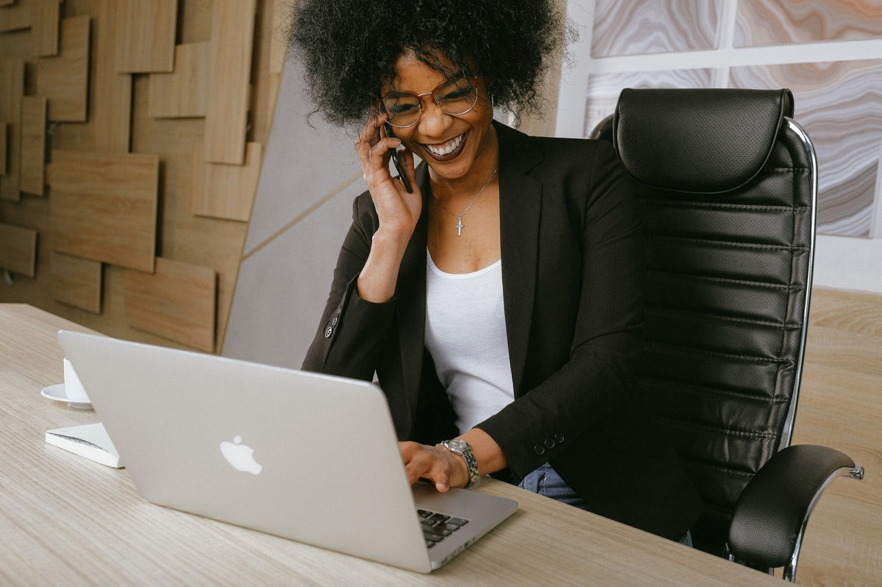 A woman thriving in a new work environment after moving from Burbank to Glendale for work.
