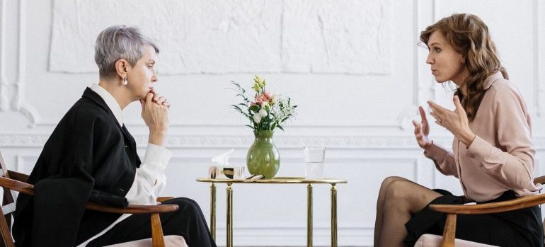 A woman talking to a therapist.